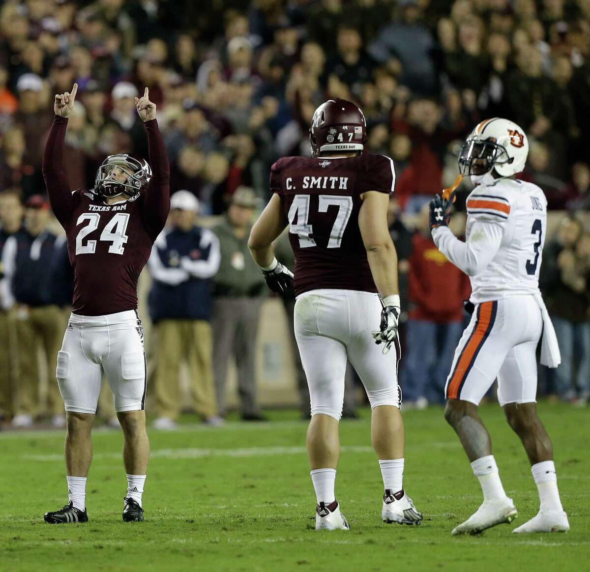 COLLEGE STATION, TX - NOVEMBER 07: Taylor Bertolet #24 of the Texas A&M Aggies celebrates after a 50 yard field goal in the first half as Caden Smith #47 and Jonathan Jones #3 of the Auburn Tigers look on at Kyle Field on November 7, 2015 in College Station, Texas. (Photo by Bob Levey/Getty Images)
