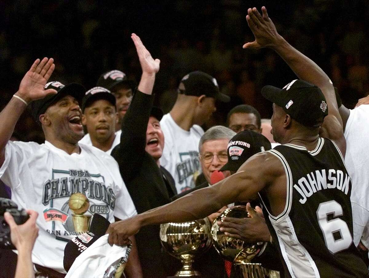 San Antonio Spurs' Avery Johnson (6) and teammate Mario Elie, left, throw up their hands for a high-five after defeating the New York Knicks 78-77 in Game 5 of the 1999 NBA Finals to clinch the championship on June 25, 1999, at New York's Madison Square Garden.