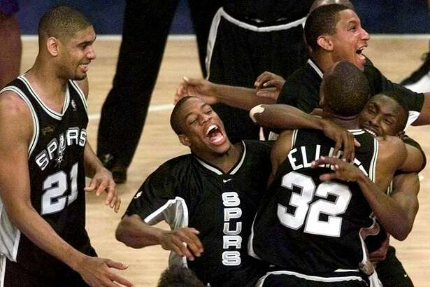 Spurs, from left, Tim Duncan, Antonio Daniels, Gerard King, Sean Elliott, and Avery Johnson celebrate after defeating the New York Knicks 78-77 in Game 5 of the 1999 NBA Finals.