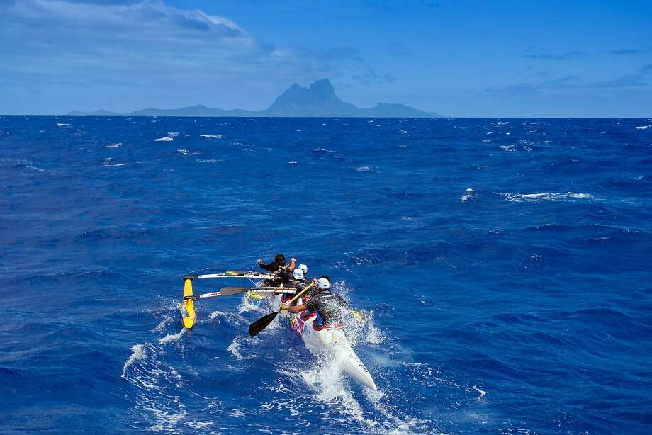 Participants compete on November 7, 2015 towards Bora Bora lagoon for the third leg of the Hawaiki Nui Va'a 2015 outrigger canoe race. The Hawaiki Nui Va'a outrigger canoe race is an annual event with more than 100 team of intense racing between Huahine, Raiatea, Taha'a and Bora Bora, honoring an ancient sport with great cultural values. The 24th edition of the race hosts teams from Taihiti, France and New Zealand, with the number of teams and countries increasing each year. Originally made in wood, almost all of the canoes are today fabricated with high tech polyester material and carbon fiber. Photo: Gregory Boissy, AFP / Getty Images