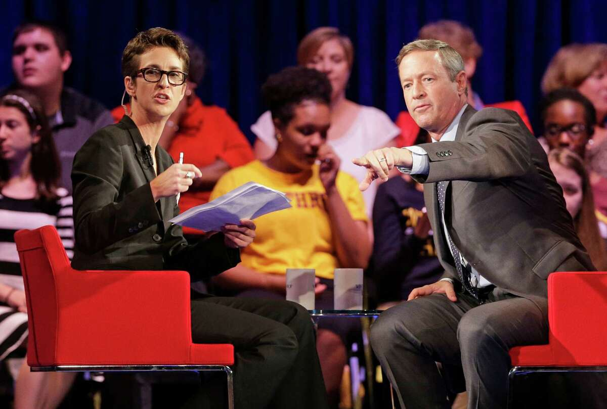 Democratic presidential candidate, former Maryland Gov. Martin O'Malley, right, gestures as MSNBC's Rachel Maddow, left, looks on during a democratic presidential candidate forum at Winthrop University in Rock Hill, S.C., Friday, Nov. 6, 2015. (AP Photo/Chuck Burton)