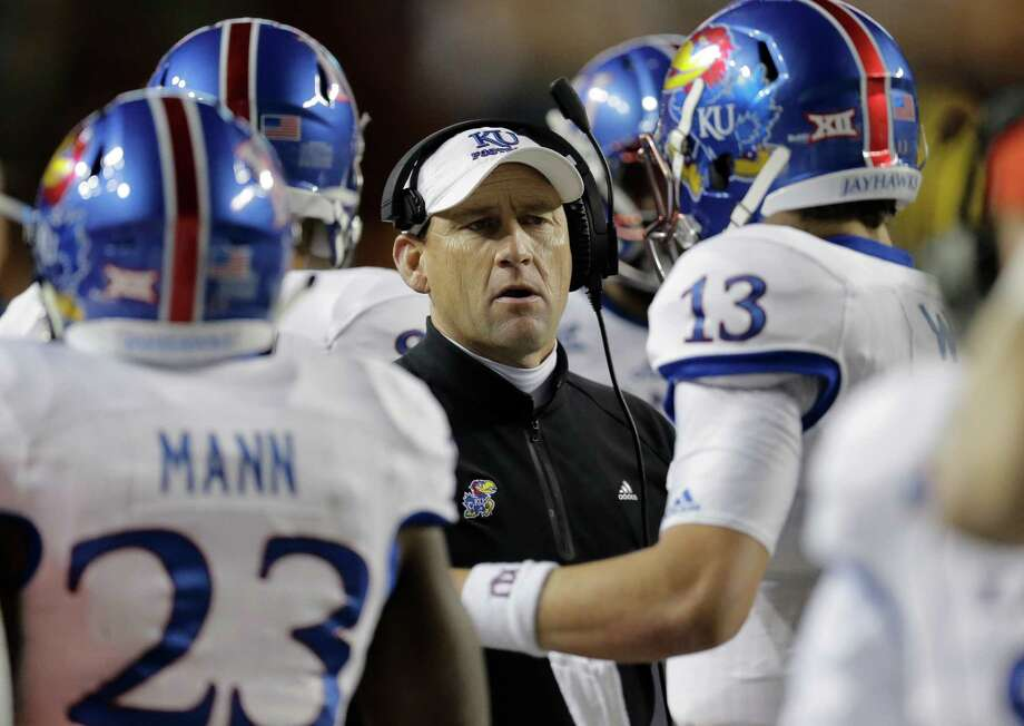 David Beaty, KansasRemember when Kansas won the Orange Bowl? That almost seems like a joke now, but it really happened. The Jayhawks went 12-1 in 2007 and won the Orange Bowl. They won eight games the next year, then the program fell off a cliff. The program's demise has led to coaching hell for Mark Mangino, Turner Gill and Charlie Weis. Now, it's Beaty's turn. He went 0-12 in his first season, but he's doing a complete rebuild of this program. It will take several years to get this mess straightened out. Beaty just hopes he'll be there when (or if) it ever does get rolling again. Photo: Eric Gay, Associated Press / AP