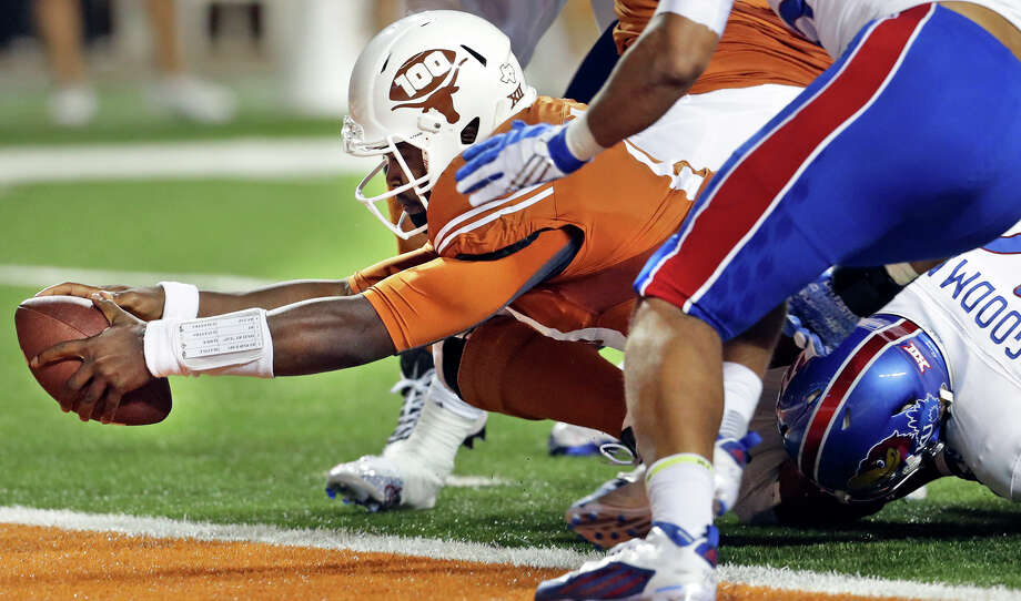 Longhorsn quarterback Tyrone Swoopes stretches to get the ball into the end zone in the first quarter as Texas hosts Kansas at Royal-Memorial Stadium on Nov. 7, 2015. Photo: Tom Reel /San Antonio Express-News / 2015 SAN ANTONIO EXPRESS-NEWS