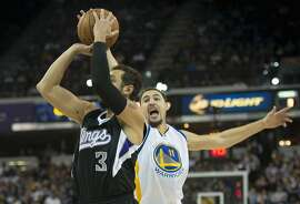 The Sacramento Kings' Marco Belinelli (3) has a shot blocked by the Golden State Warriors' Klay Thompson (11) during the first half at Sleep Train Arena in Sacramento, Calif., on Saturday, Nov. 7, 2015. (Hector Amezcua/Sacramento Bee/TNS)