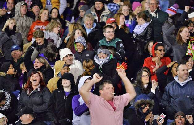 Amsterdam fans cheer their team during their Class A championship game against Troy High Saturday Nov. 7, 2015 in Clifton Park, NY.   (John Carl D'Annibale / Times Union) Photo: John Carl D'Annibale / 00034113A