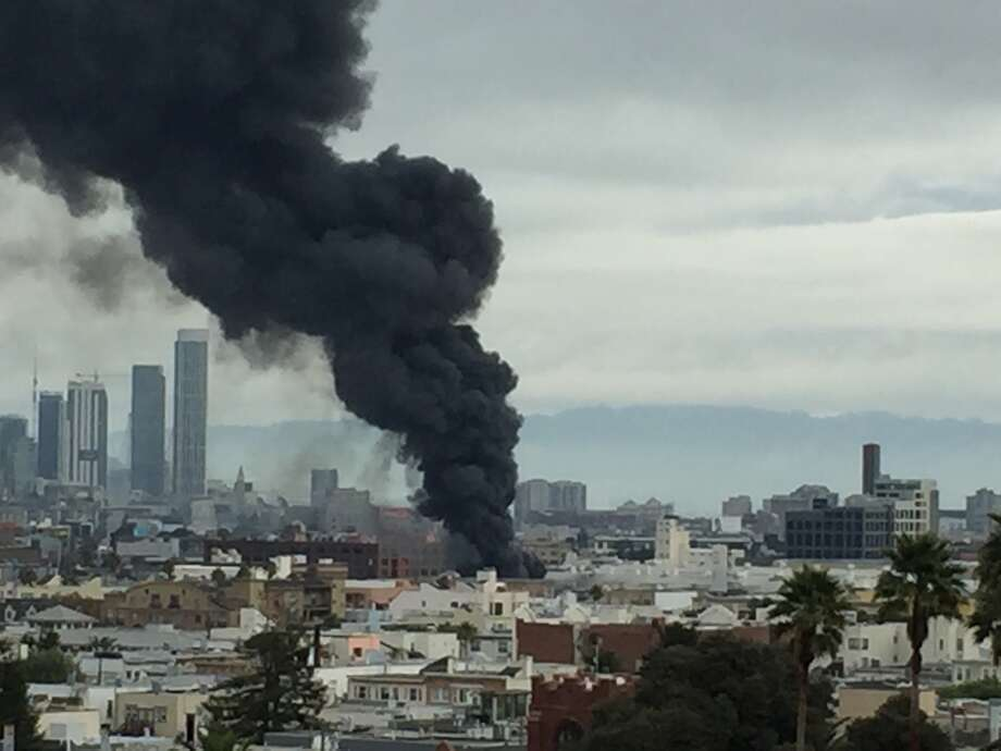 Fire in Mission District burns tire store, displaces ...
