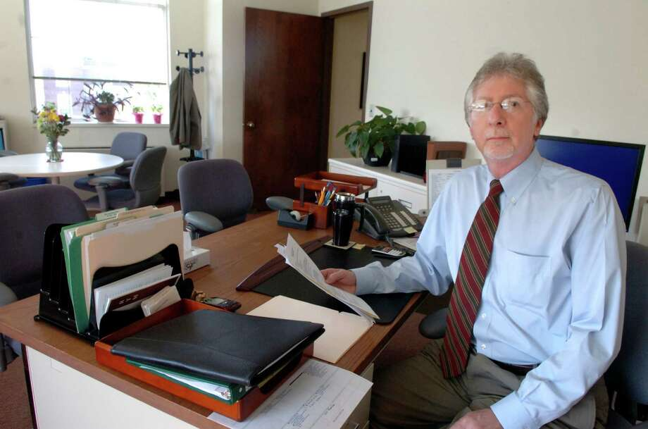 Alan Barry, director of the Greenwich Department of Social Services, sits in his office at Town Hall in this file photo. Social Services has created a task force to help resolve Greenwich's student achievement gap. Photo: Helen Neafsey / Greenwich Time / Greenwich Time