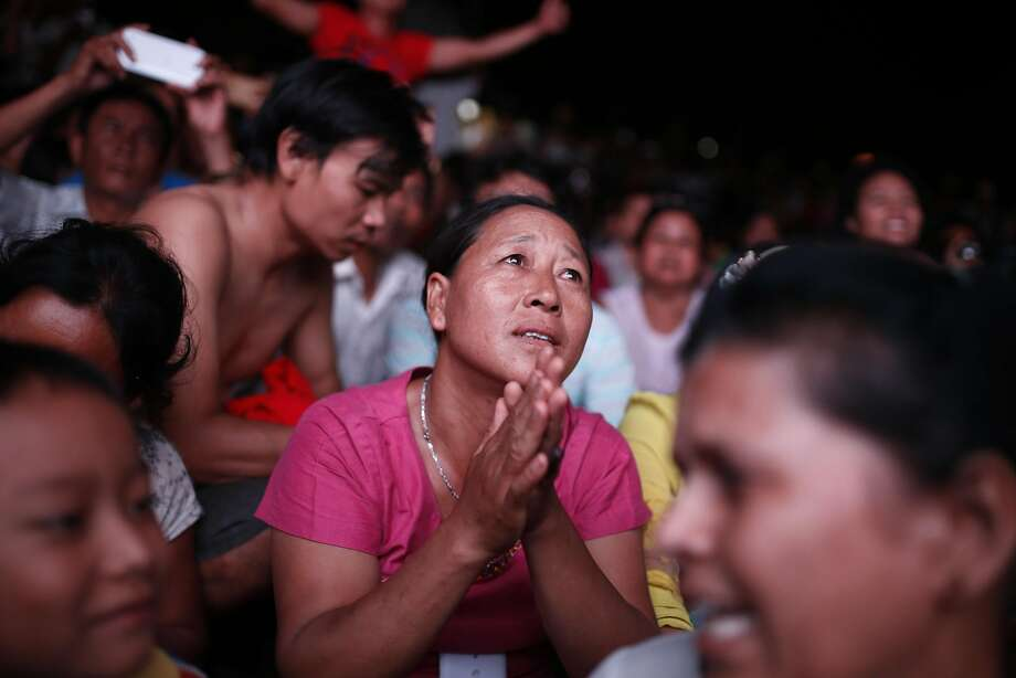 Supporters of opposition leader Aung San Suu Kyi gather to await voting returns in Mandalay, Burma. Photo: Hkun Lat, Associated Press