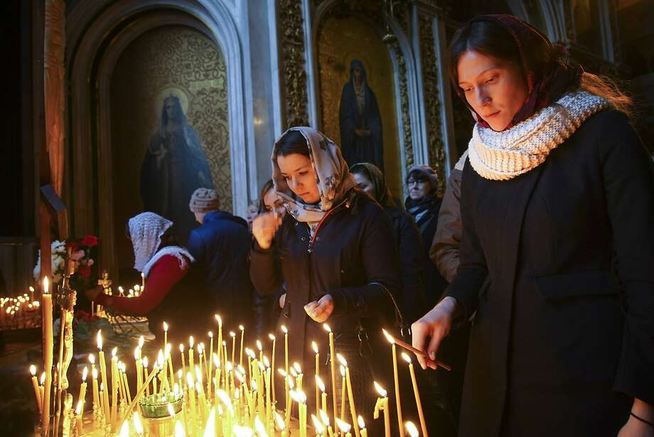 Candles are lit at St. Isaac's Cathedral in St. Petersburg, Russia, for the 224 victims of the Russian jetliner crash in Egypt. Most of the victims were from the St. Petersburg region. Photo: Mstyslav Chernov, Associated Press