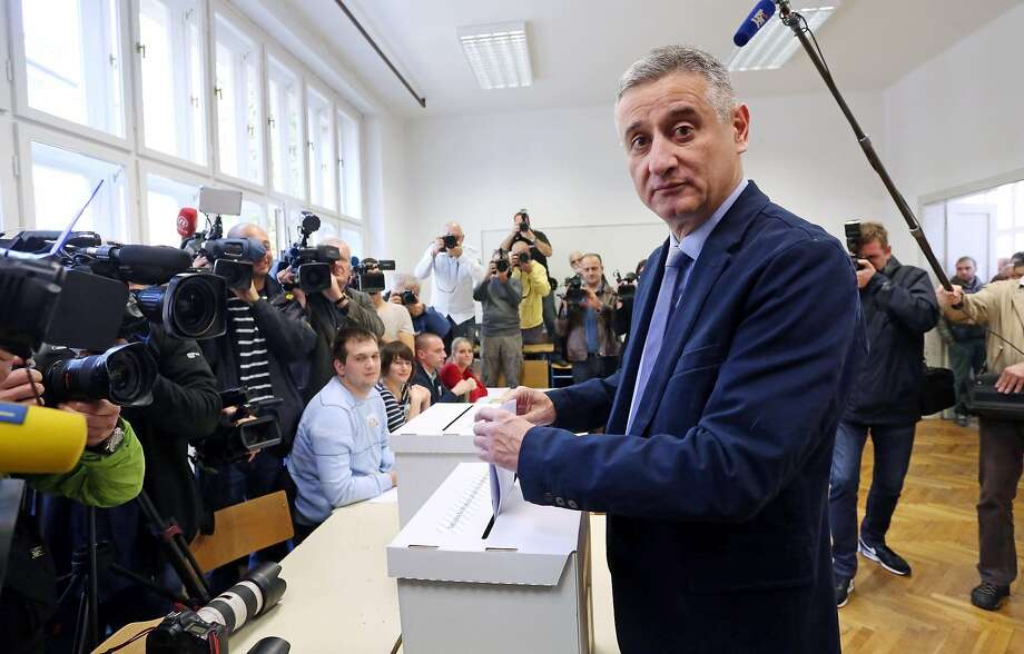 Tomislav Karamarko, leader of the conservative opposition Croatian Democratic Union party, casts his ballot in Zagreb. Karamarko campaigned on patriotism and creating new jobs. Photo: Str, AFP / Getty Images