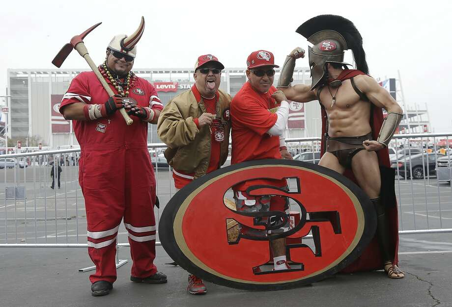 San Francisco 49ers fans tailgate pose for photos at Levi's Stadium before an NFL football game between the San Francisco 49ers and the Atlanta Falcons in Santa Clara, Calif., Sunday, Nov. 8, 2015. (AP Photo/Jeff Chiu) Photo: Jeff Chiu, Associated Press
