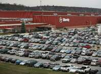 Hundreds of employee cars fill the parking lots at Sikorsky Helicopters in Stratford.