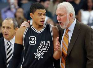 Spurs' Ray McCallum talks with head coach Gregg Popovich during second half action against the Brooklyn Netson Oct. 30, 2015 at the AT&T Center.