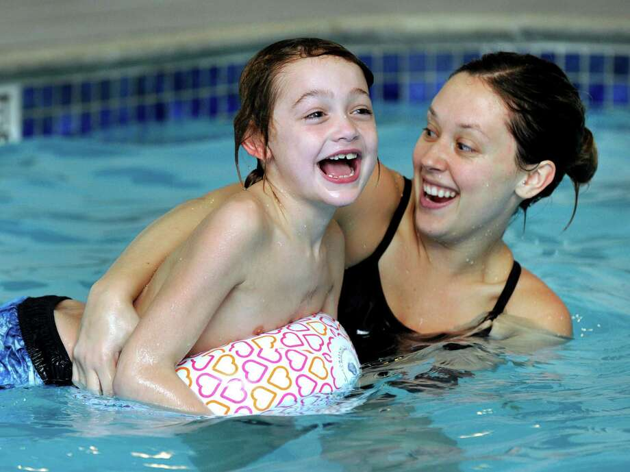 Charlie Flanagan, 7, of Danbury, laughs in the water with instructor Jessie Lippi, of New Milford. The class, Swim Whisperers, uses the pool at the Quality Inn in Danbury. Photo: Carol Kaliff / Hearst Connecticut Media / The News-Times