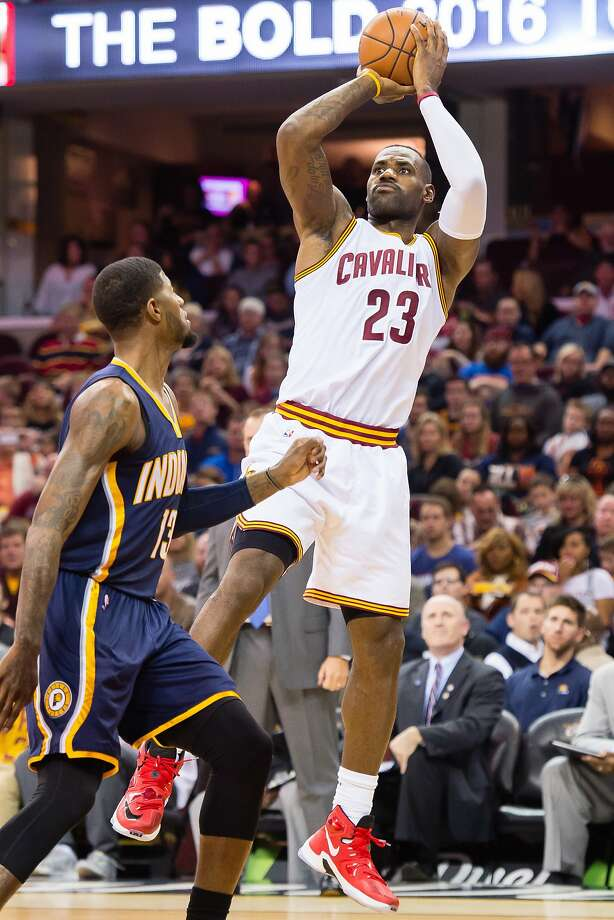 CLEVELAND, OH - NOVEMBER 8: LeBron James #23 of the Cleveland Cavaliers shoots over Tristan Thompson #13 of the Cleveland Cavaliers during the first half at Quicken Loans Arena on November 8, 2015 in Cleveland, Ohio. NOTE TO USER: User expressly acknowledges and agrees that, by downloading and or using this photograph, User is consenting to the terms and conditions of the Getty Images License Agreement. (Photo by Jason Miller/Getty Images) Photo: Jason Miller, Getty Images