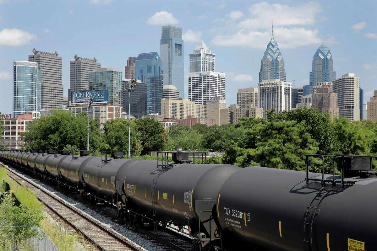 Train tank cars with placards indicating petroleum crude oil stand idle on the tracks in Philadelphia. Oil producers have come to like the flexibility railroads offer. Shipping by rail allows oil producers to send their product to different markets to obtain the best price.