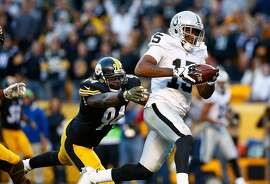 PITTSBURGH, PA - NOVEMBER 08:  Michael Crabtree #15 of the Oakland Raiders catches a game tying touchdown pass in front of Lawrence Timmons #94 of the Pittsburgh Steelers in the 4th quarter of the game at Heinz Field on November 8, 2015 in Pittsburgh, Pennsylvania.  (Photo by Jared Wickerham/Getty Images)