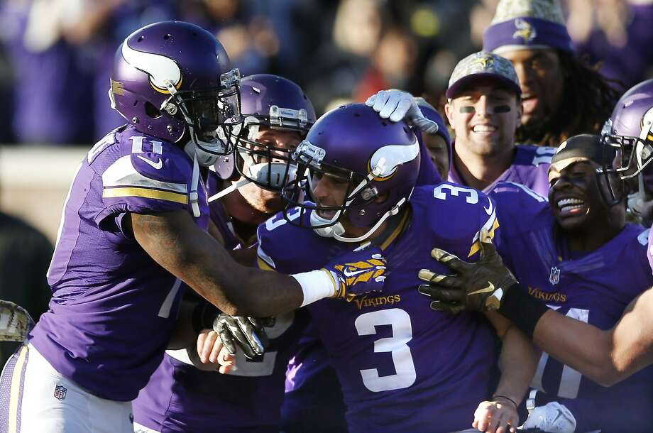 Kicker Blair Walsh (3) is surrounded by Minnesota teammates after his 40-yard field goal in overtime beat the Rams. Photo: Jim Mone, Associated Press