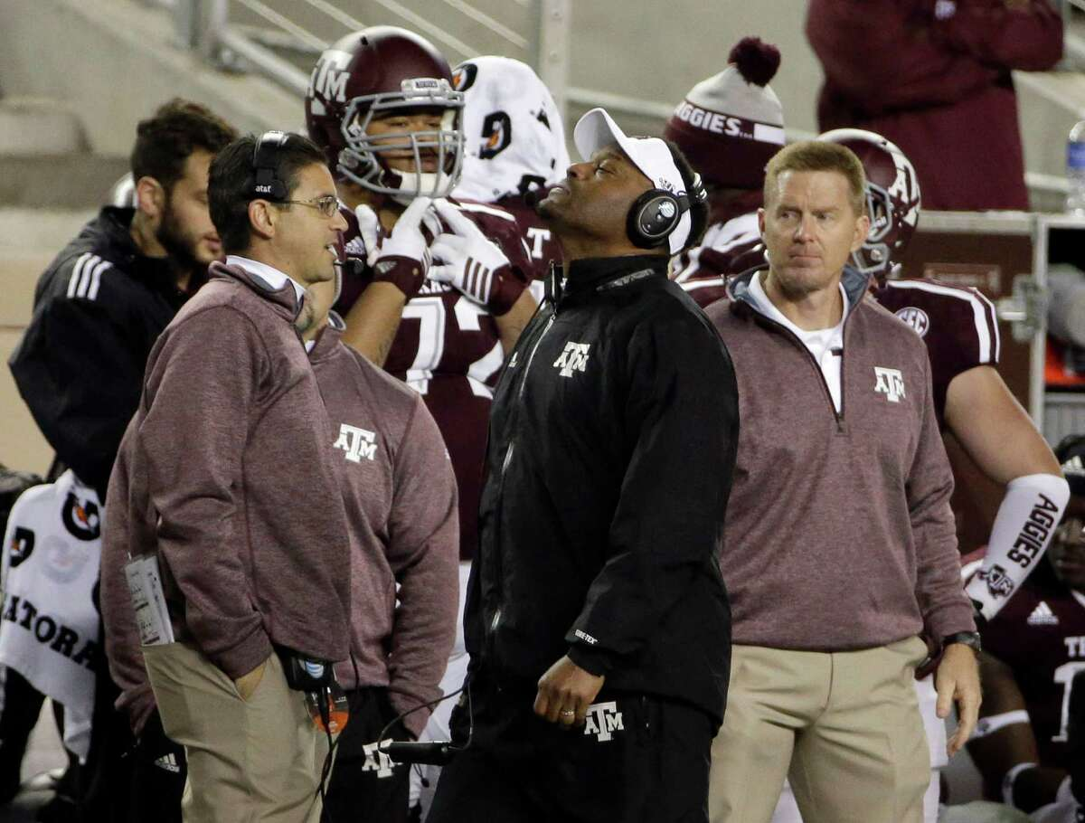 Texas A&M coach Kevin Sumlin, center, walks down the sideline during the second half of an NCAA college football game against Auburn Saturday, Nov. 7, 2015, in College Station, Texas. Auburn won 26-10. (AP Photo/David J. Phillip)