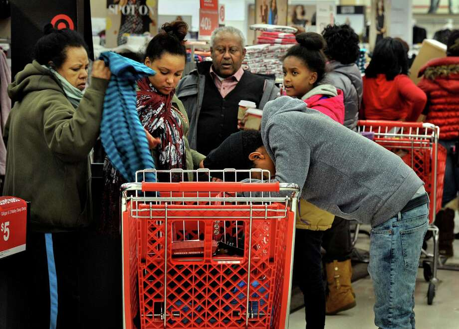 While some retailers are scaling back hours around the Thanksgiving holiday, the season is too critical for big chains such as Target to turn back. Photo: Washington Post File Photo / The Washington Post