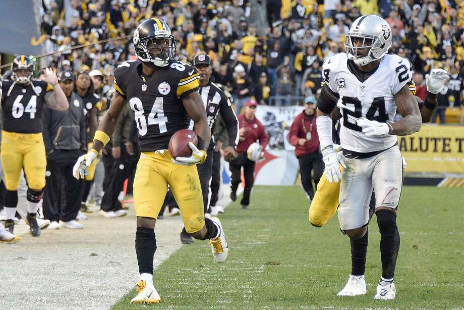 Pittsburgh Steelers wide receiver Antonio Brown (84) runs past Oakland Raiders free safety Charles Woodson (24) after making a catch to help set up the Steelers game-winning field goal in the second half of an NFL football game Sunday, Nov. 8, 2015, in Pittsburgh. (AP Photo/Don Wright) Photo: Don Wright, Associated Press