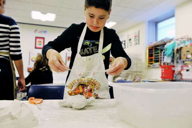 Facundo Aguiar, 10, of Albany mummifies a teddy bear at the Albany Institute of History and Art during their Mummy Birthday on Sunday, Nov. 8, 2015, in Albany, N.Y.  The event marks the 106th anniversary of the arrival of the mummies to the museum.  Children could mummify one of their toys or if they didn't want to permanently mummify one of their toys the museum had small stuffed animals for them to use instead.   (Paul Buckowski / Times Union) Photo: PAUL BUCKOWSKI / 00034124A