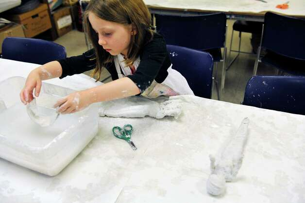 Elizabeth Scaringe, 6, of Colonie mummifies one of her Barbie dolls at the Albany Institute of History and Art during their Mummy Birthday on Sunday, Nov. 8, 2015, in Albany, N.Y.  The event marks the 106th anniversary of the arrival of the mummies to the museum.  (Paul Buckowski / Times Union) Photo: PAUL BUCKOWSKI / 00034124A