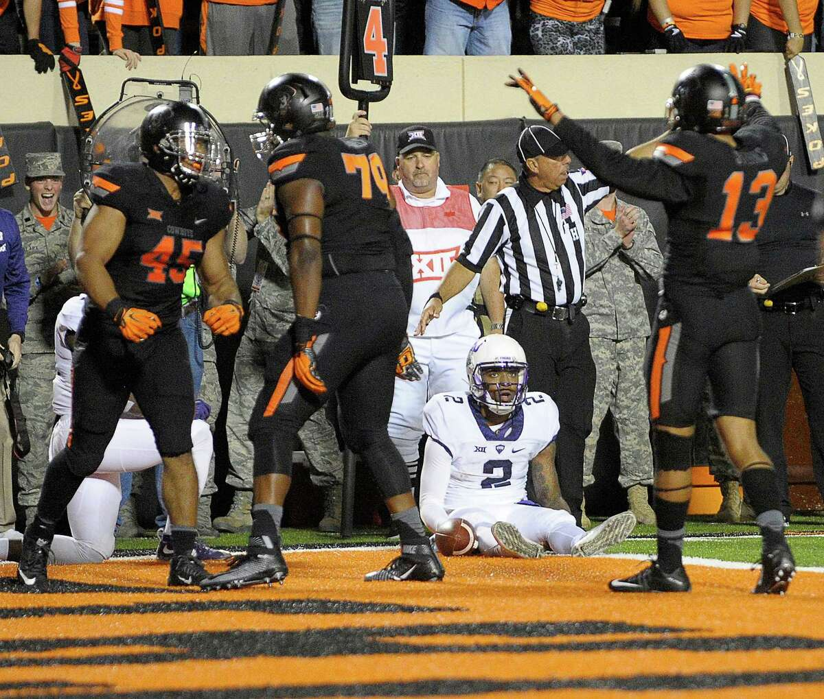 TCU quarterback Trevone Boykin (2) is stopped short of the end zone and the ball goes over to Oklahoma State in the fourth quarter at Boone Pickens Stadium in Stillwater, Okla., on Saturday, Nov. 7, 2015. The host Cowboys won, 49-29. (Max Faulkner/Fort Worth Star-Telegram/TNS)