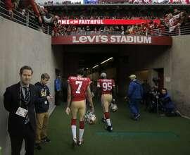 Colin Kaepernick (7) walks off the field toward the locker room as the San Francisco 49ers played the Atlanta Falcons at Levi's Stadium in Santa Clara, Calif., on Sunday, November 8, 2015.