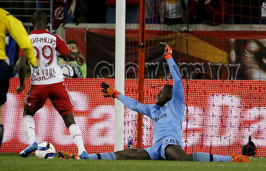 Bradley Wright-Phillips (99) scored the game's only goal, beating D.C. United goalie Bill Hamid in injury time. Photo: Julio Cortez, Associated Press