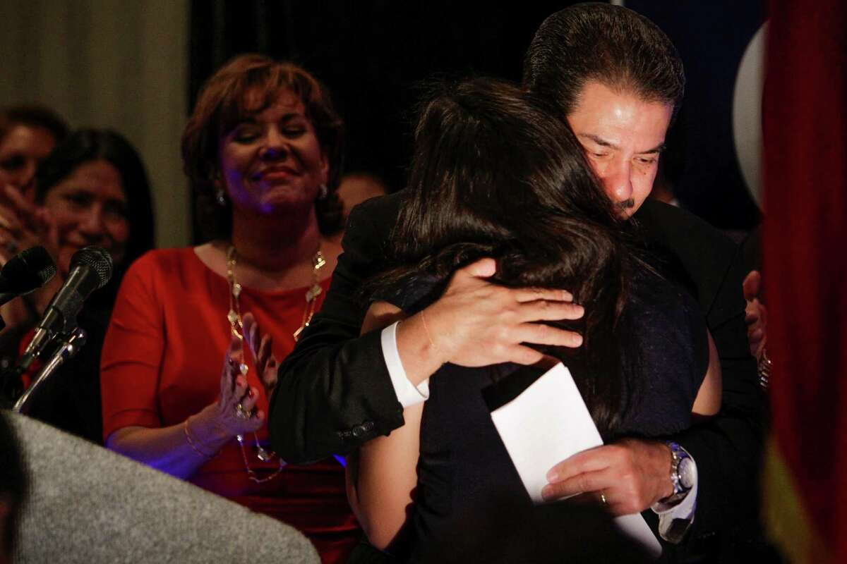 Houston mayoral candidate Adrian Garcia hugs his daughter after conceding the race at his watch party last week.