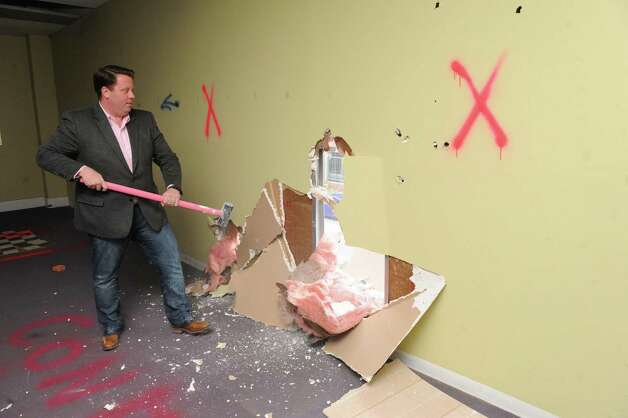 Tom Nardacci, left, Gramercy Communications founder & principal, plans on turning 22-24 Fourth Street into the Troy Innovation Garage, an incubator for creative economy startups on Friday Nov. 6, 2015 in Troy, N.Y.  (Michael P. Farrell/Times Union) Photo: Michael P. Farrell / 00034098A