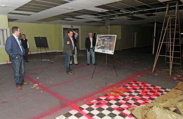 Tom Nardacci, center, Gramercy Communications founder & principal, plans on turning 22-24 Fourth Street into the Troy Innovation Garage, an incubator for creative economy startups on Friday Nov. 6, 2015 in Troy, N.Y.  (Michael P. Farrell/Times Union) Photo: Michael P. Farrell / 00034098A