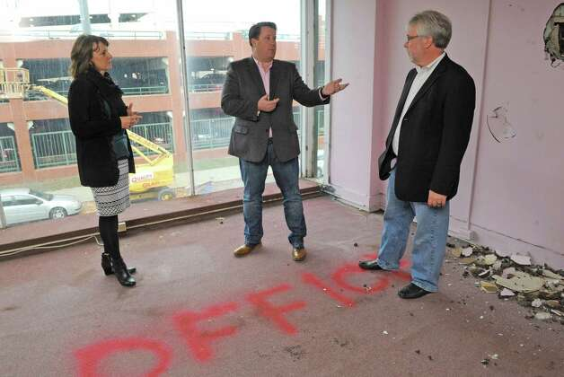 Tom Nardacci, center, Gramercy Communications founder & principal, plans on turning 22-24 Fourth Street into the Troy Innovation Garage, an incubator for creative economy startups on Friday Nov. 6, 2015 in Troy, N.Y.  Also pictured Monica Kurzejeski, left, Troy director economic development coordinator, and Scott Townsend, owner of 3t Architecture.  (Michael P. Farrell/Times Union) Photo: Michael P. Farrell / 00034098A