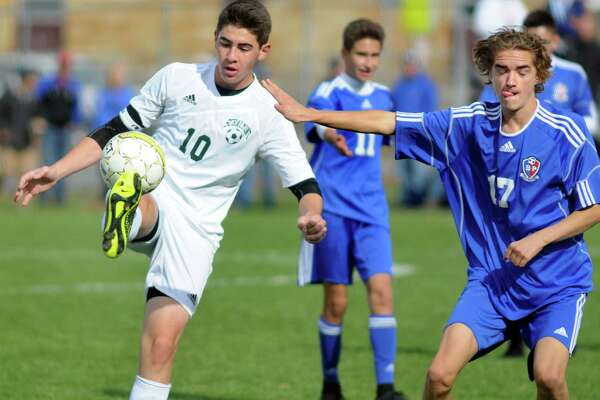 Schalmont's Chris Hamilton, left, connects with the ball as Broadalbin's Cameron Monks defends during their Section II Class B boys' soccer final on Saturday, Oct. 31, 2015, at Colonie High in Colonie, N.Y. (Cindy Schultz / Times Union)