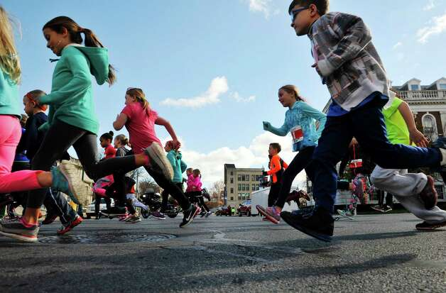 Children make their way along Jay Street in the Children's Run at the MVP Health Care Stockade-athon on Sunday, Nov. 8, 2015, in Schenectady, N.Y.  (Paul Buckowski / Times Union) Photo: PAUL BUCKOWSKI / 00034088A