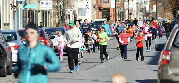 Children make their way along Jay Street in the Children's Run at the MVP Health Care Stockade-athon on Sunday, Nov. 8, 2015, in Schenectady, N.Y.  (Paul Buckowski / Times Union) Photo: PAUL BUCKOWSKI / 00034088A