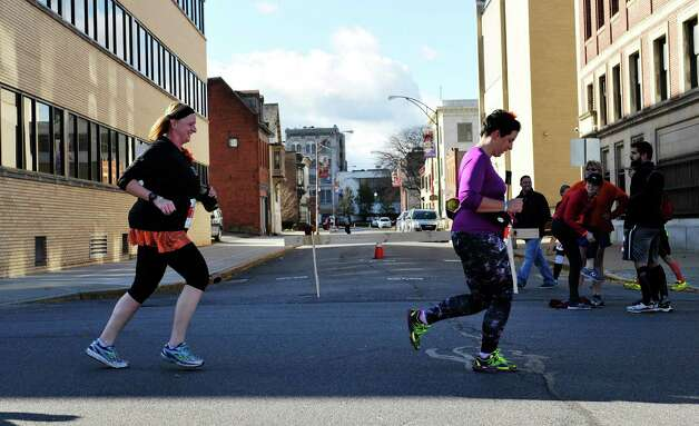 Runners make their way down Franklin Street towards the finish line in the MVP Health Care Stockade-athon on Sunday, Nov. 8, 2015, in Schenectady, N.Y.  (Paul Buckowski / Times Union) XXX the MVP Health Care Stockade-athon on Sunday, Nov. 8, 2015, in Schenectady, N.Y.  (Paul Buckowski / Times Union) Photo: PAUL BUCKOWSKI / 00034088A