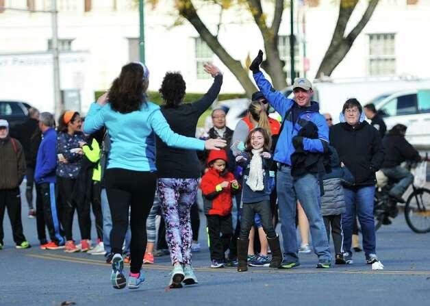 Family and friends cheer on runners at the MVP Health Care Stockade-athon on Sunday, Nov. 8, 2015, in Schenectady, N.Y.  (Paul Buckowski / Times Union) Photo: PAUL BUCKOWSKI / 00034088A