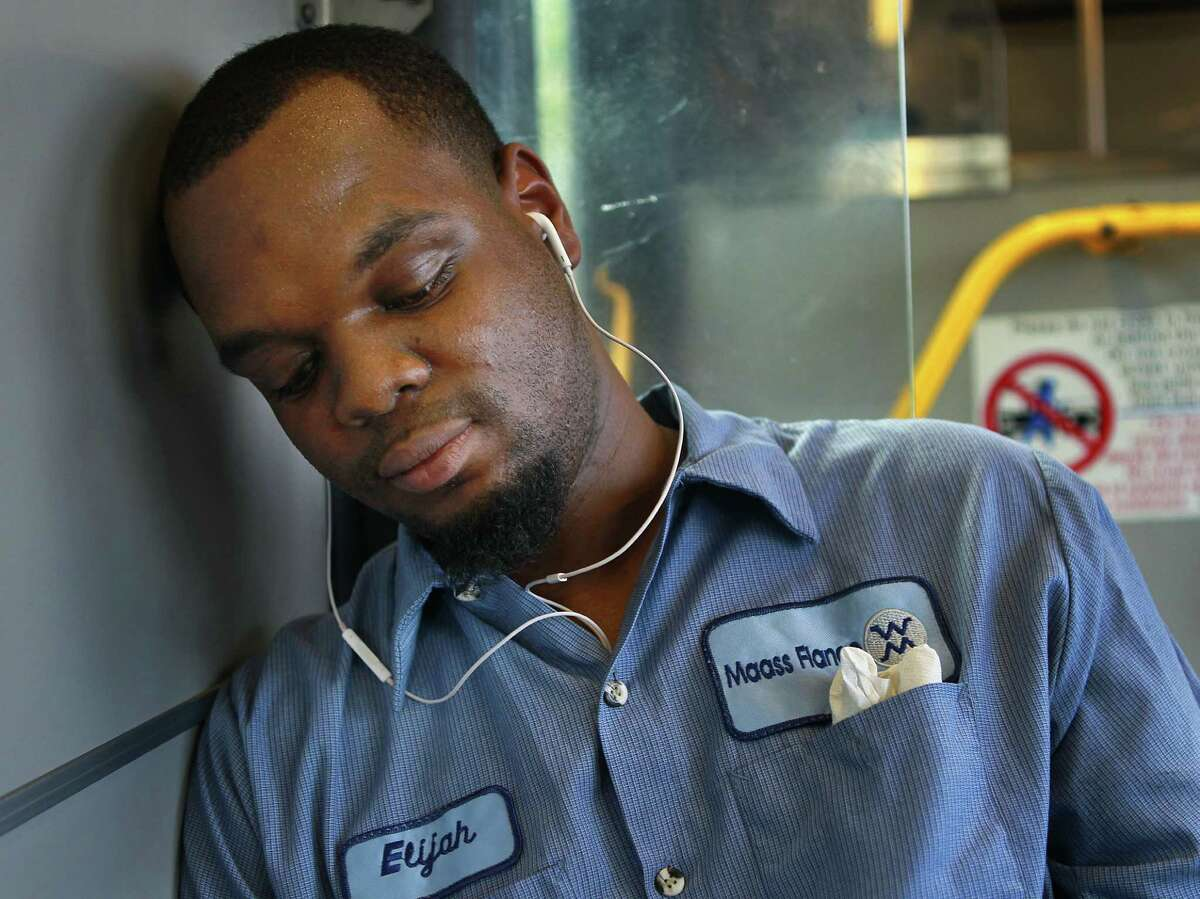 Elijah Taylor rides home from his job at a machine shop on Metro's 85 bus route out of downtown on Nov. 5. Taylor said he feels he gets home about 10 minutes faster since Metro changed their route system.