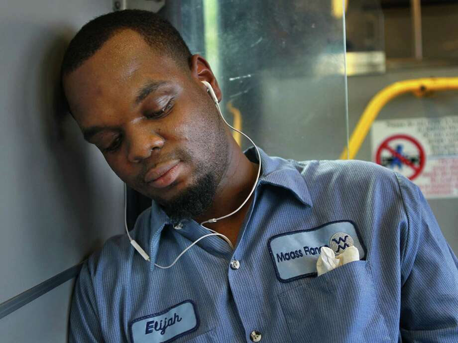 Elijah Taylor rides home from his job at a machine shop on Metro's 85 bus route out of downtown on Nov. 5. Taylor said he feels he gets home about 10 minutes faster since Metro changed their route system. Photo: Mark Mulligan, Houston Chronicle / © 2015 Houston Chronicle