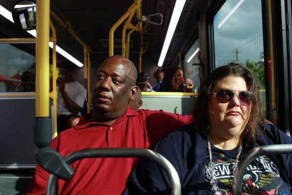 Benjamin Gordon and Lorisse Hughes ride Metro's 85 bus route out of downtown, Thursday, Nov. 5, 2015, in Houston. The couple uses the route every day when they go to downtown to church and to job hunt. They have enjoyed the change in the frequency of buses.
