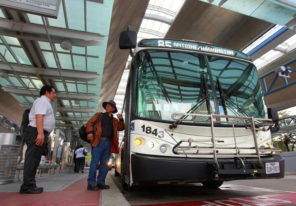 Riders board Metro's Route 85 bus at the Downtown Transit Center on Nov. 5.