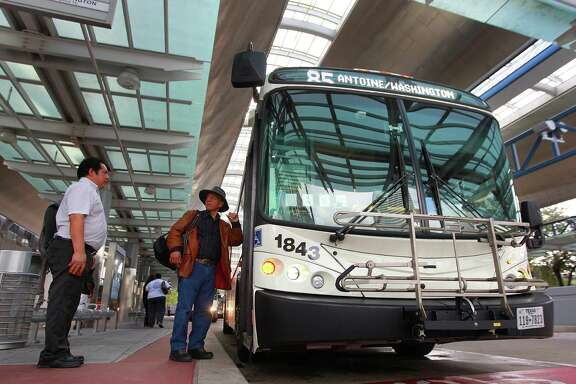 Riders board Metro's 85 bus at the downtown Transit Center, Thursday, Nov. 5, 2015, in Houston.