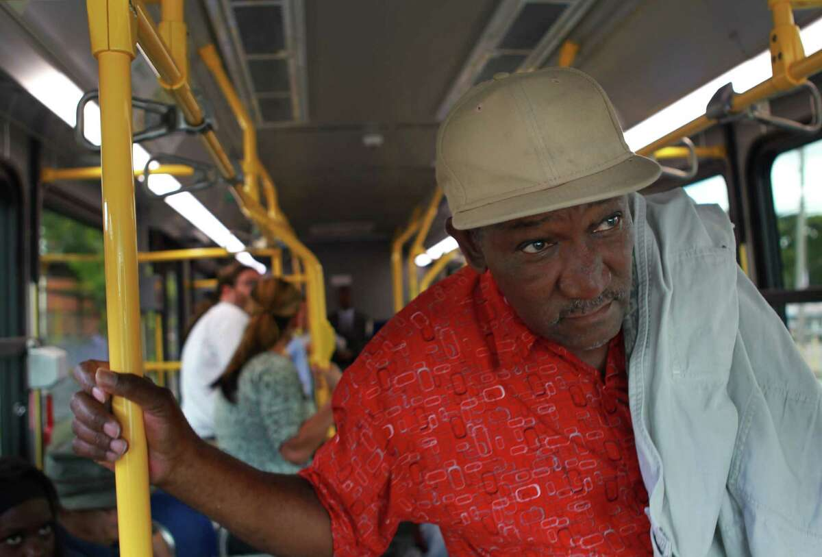 Larry Jackson looks for his stop while riding Metro's Route 85 bus out of downtown on Nov. 5.