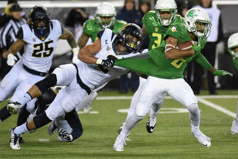 EUGENE, OR - NOVEMBER 07: Running back Daniel Lasco #2 of the California Golden Bears grabs ahold of wide receiver Charles Nelson #6 of the Oregon Ducks jersey duringg a kick off return in the first quarter of the game at Autzen Stadium on November 7, 2015 in Eugene, Oregon.  (Photo by Steve Dykes/Getty Images) Photo: Steve Dykes / Getty Images / 2015 Getty Images