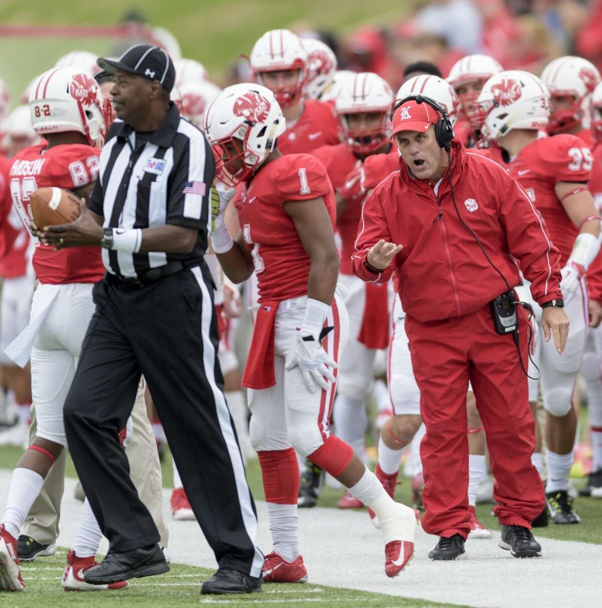 Katy Tigers Head Coach, Gary Rogers shouts instructions to his offense in the first half against the Cinco Ranch Cougars in a high school football game on Saturday, November 7, 2015 at Rhodes Stadium.