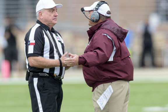 Cinco Ranch Cougars Head Coach, Don Clayton, complains to the Referee about a call in the first half against the Katy Tigers  in a high school football game on Saturday, November 7, 2015 at Rhodes Stadium.