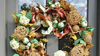 Nature makes welcoming wreaths. Pinecones, leaves, grapevine, wheat stalks, grasses and twigs make a sturdy backdrop for a harvest motif. Thistle berries, bittersweet, colorful leaves, fern, magnolias, ivy, eucalyptus and hydrangeas add color.  For texture, add moss, feathers or even cotton. Here are some wreaths we spotted, beckoning guests to come inside.