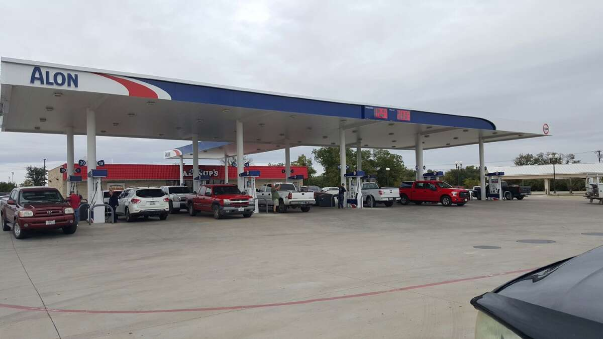 Cars line up at a gas station located at 2725 W Washington St. in Stephenville, Texas on Nov. 9, 2015.